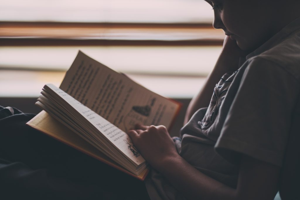 Boy reading a business book